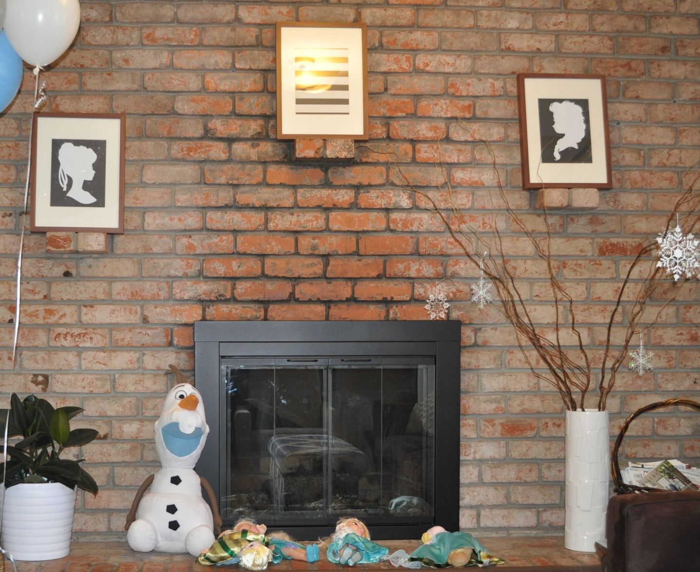 The girls' Olaf and Elsa and Anna dolls, along with Anna and Elsa cut-outs in the frames. I'm a scissor master