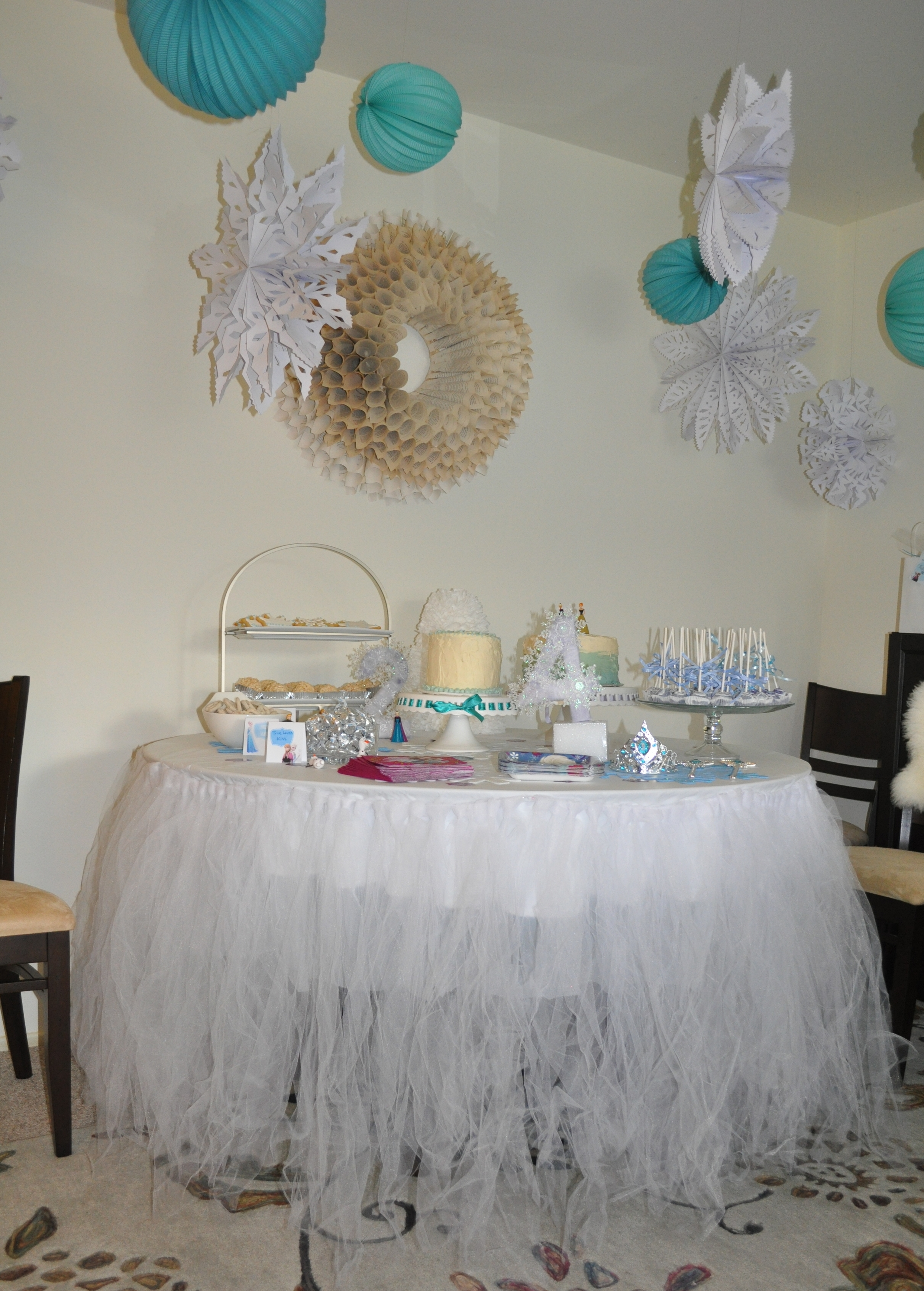 Hanging lanterns and snowflakes, plus a recycled table tutu from last year