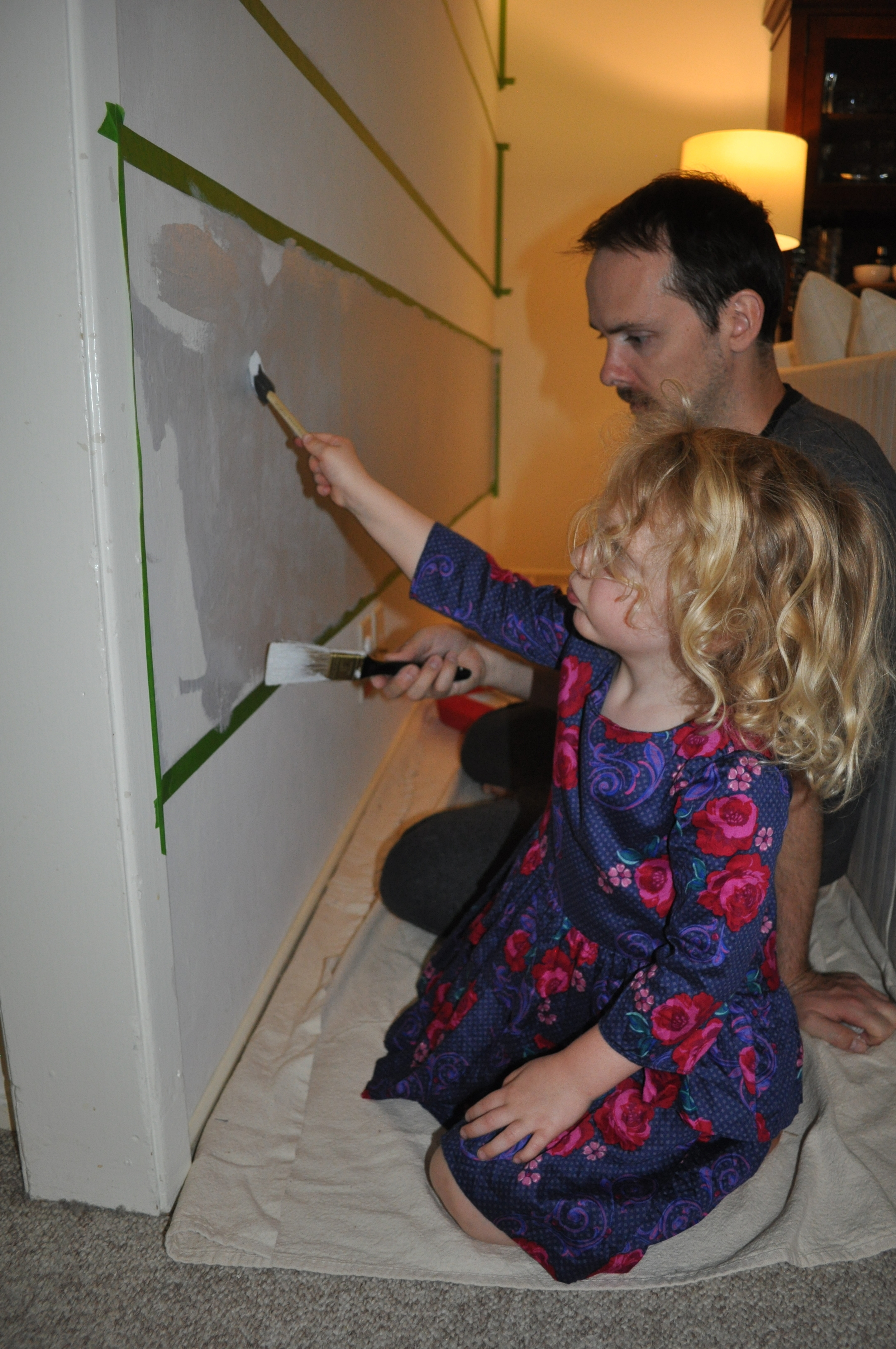G getting a lesson in painting from her Daddy