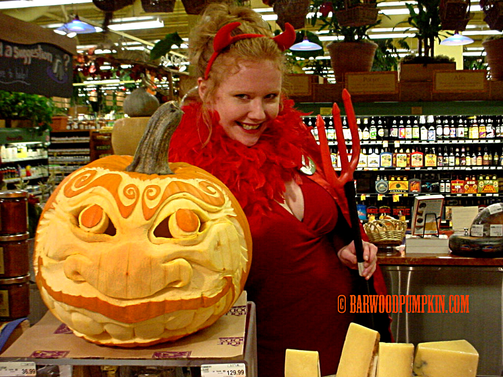 My lovely wife modeling a pumpkin at Whole Foods