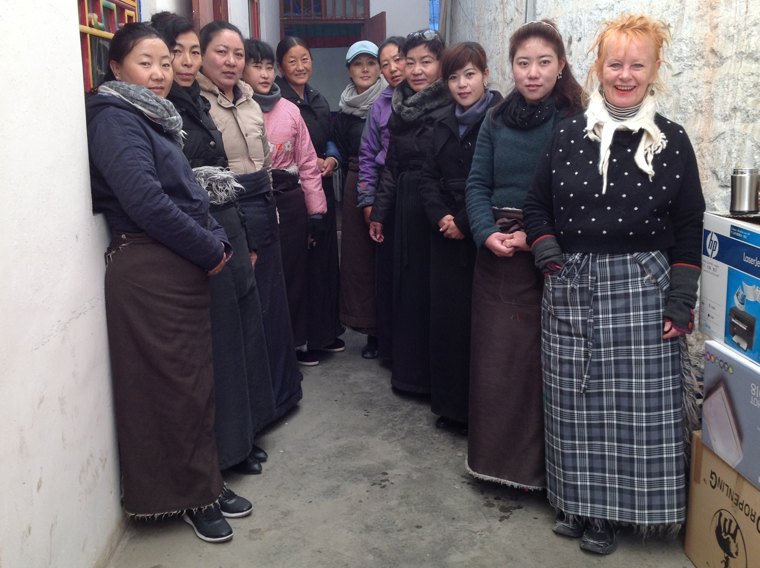 The tailors and I with our furry skirts. Lots of Tibetans have these on hand to wrap around them when they are sitting in chilly rooms. Then you take them off to go outside in the warm sun.