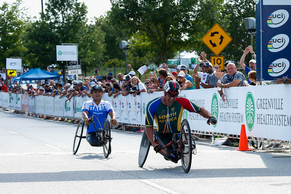 Photo: Ernst van Dyk claims the World Championship gold medal in an epic finish line sprint against defending World Champion Allesandro Zanardi in Greenville SC, USA, earlier this year. Photo credit:  http://www.greenvillesc2014.com/