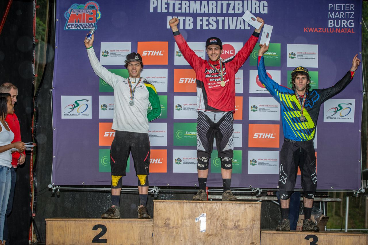 The elite men's podium after the downhill nationals at the Pietermaritzburg MTB Festival at the Cascades MTB Park on Sunday, (from left) Tiaan Odendaal, (2nd), Sam Bull (1st) and Tim Bentley (3rd).©     craigdutton.com