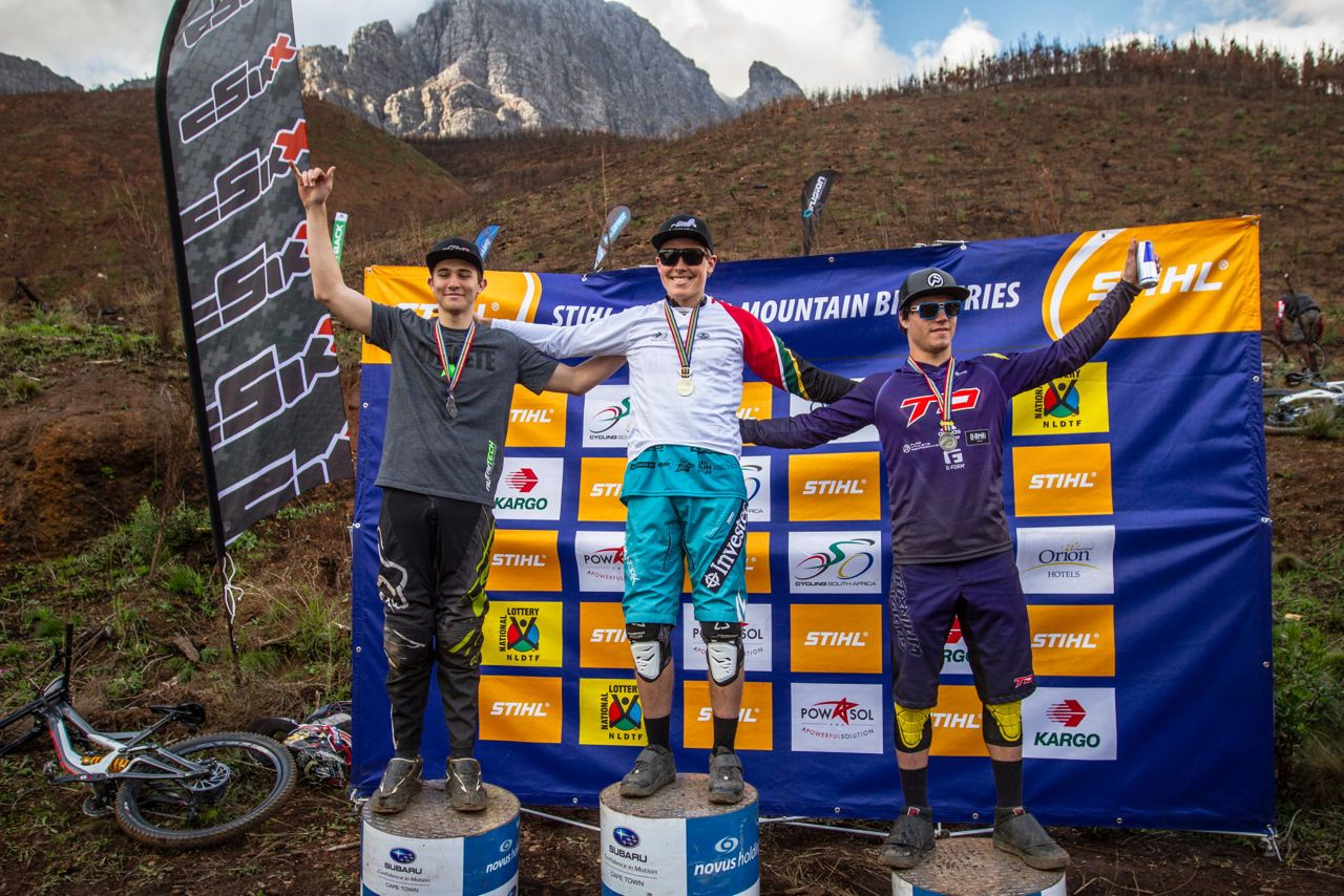 From Left: Theo Erlangsen (second), Stefan Garlicki (first) and Tiaan Odendaal (third) celebrate at the protocol ceremony at the 2015 Stihl South African Mountain Bike Championships presented by Subaru Cape Town/Novus Holdings on Sunday 19 July.