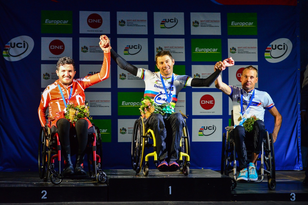 South African World Champion Pieter du Preez won gold in the Men's H1 hand cycle race, and is flanked by silver medallist Patrik Jahoda (CZE left) and Teppo Polvi (FIN right) on day one of the 2015 UCI Para-cycling Road World Cup in Pietermaritzburg on Friday 11 September. Photo credit: Darren Goddard