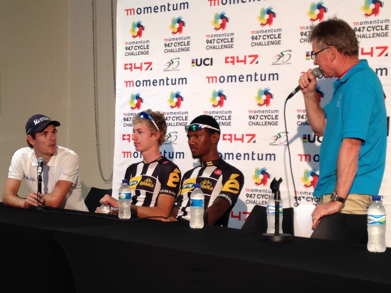 (From left) Orica-GreenEDGE's Daryl Impey, who came in at a well-fought third place, chats with MTN-Qhubeka Feeder Team's Stefan de Bod (first) and Clint Hendriks (second) to MC Paul Valstar after the 2015 Momentum 947 Cycle Challenge Elite Men's race in Gauteng on Sunday 15 November. Photo: Supplied