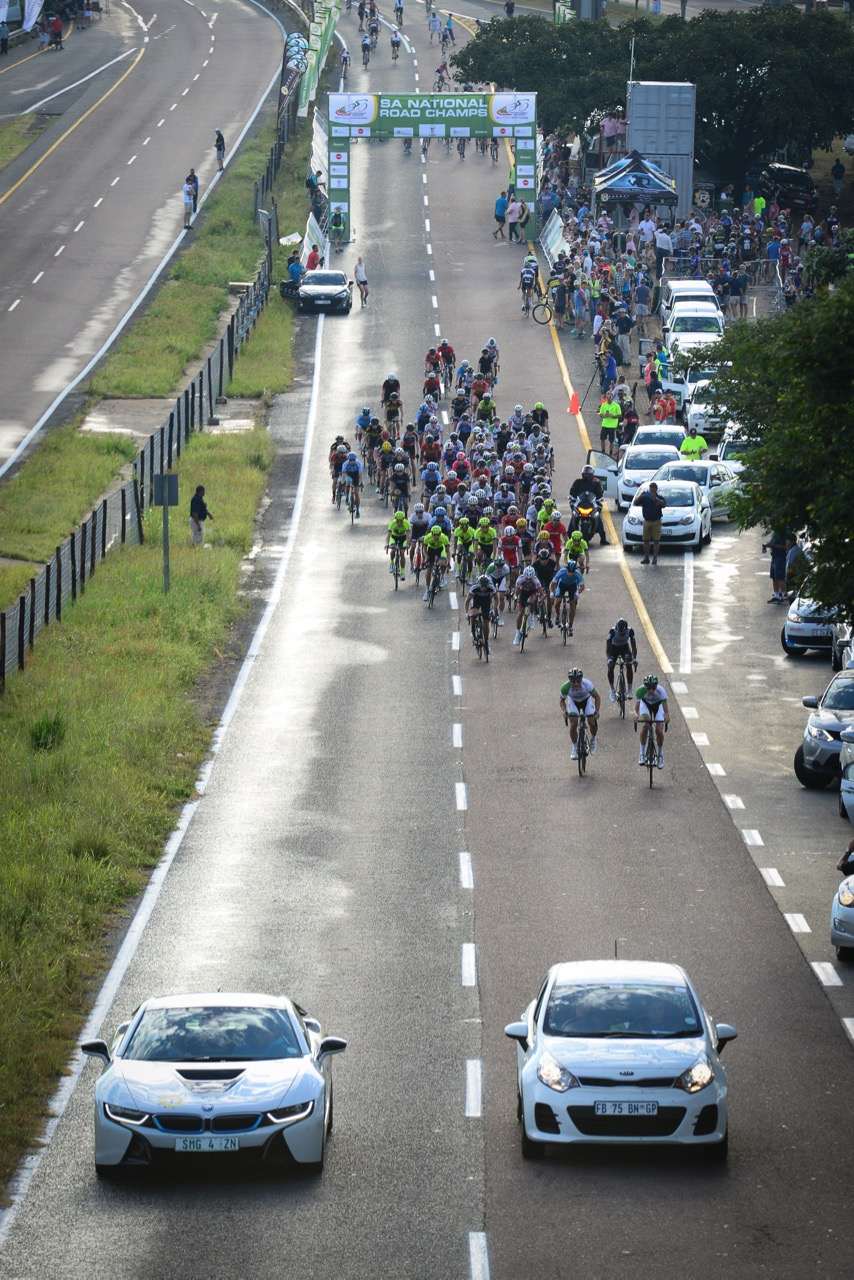The cool 07:00 start of the 170km Elite Men's race before the weather heated up to the high 30s at the 2016 SA National Road, Time Trial and Para-cycling Championships in Westville, KwaZulu-Natal,on Sunday 14 February.Photo credit: Darren Goddard