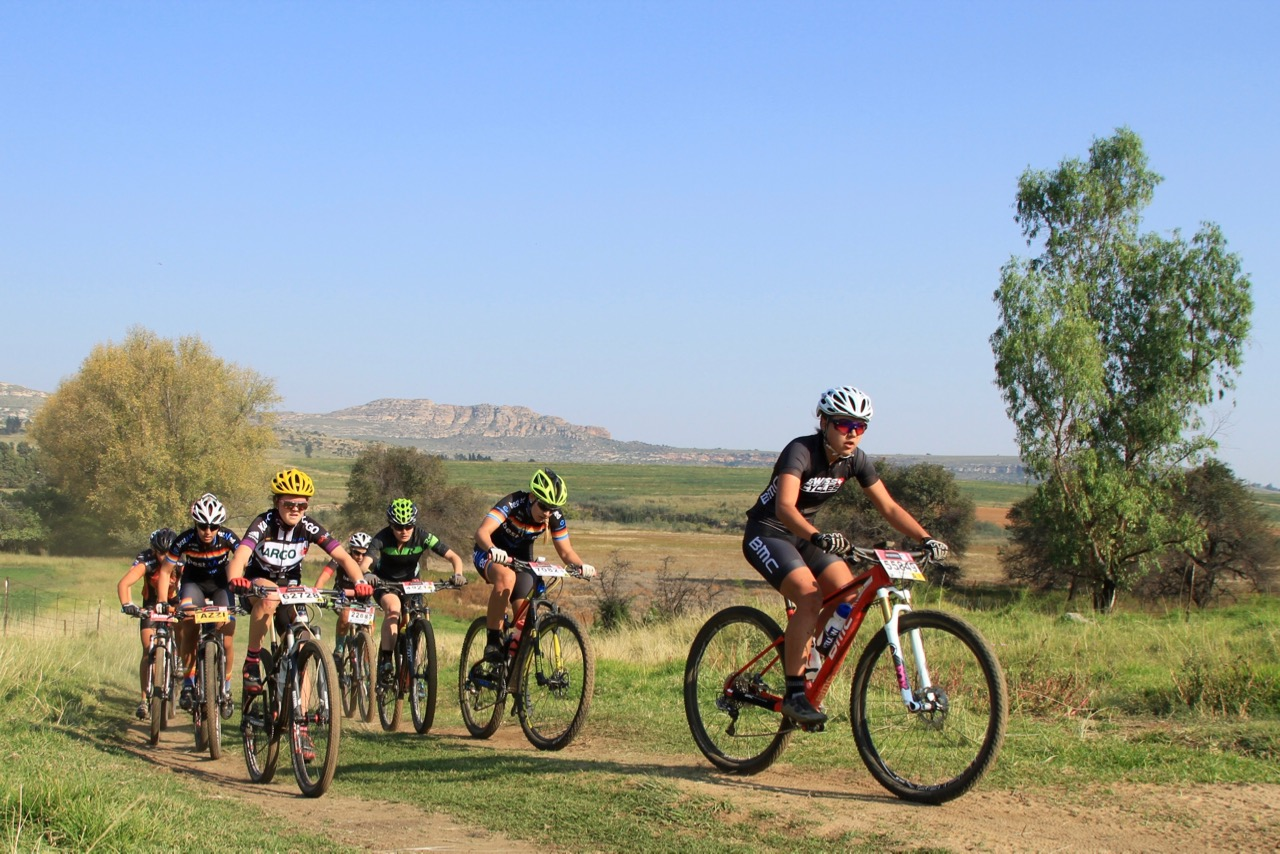Front of picture: Danielle Strydom (17 - Swiss Cycles) won the Junior Women's race to claim the South African MTB Marathon Champion title over the 43.5-kilometre half-marathon route in a time of one hour 58 minutes and eight seconds at the third round of the Ashburton Investments National MTB Series this year, which played host to the 2016 South African Mountain Bike Marathon Championships in Clarens, on Sunday 17 April. Photo: supplied