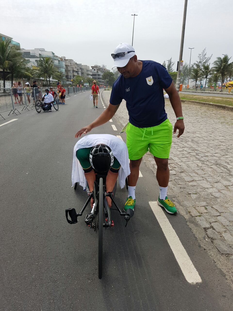 An exhausted but overwhelmed Ernst van Dyk takes a moment to realise his Gold medal win in the Men's H5 Road Race at the 2016 Rio Paralympics on Thursday 15 September.