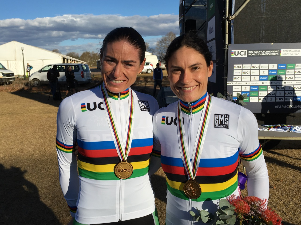 Team Ireland's Eve McCrystal (pilot, left) and Katie-George Dunley proudly wear their gold medals and rainbow jerseys after winning the Women's Visually Impaired race during the Time Trial on Day 2 of the 2017 UCI Para-cycling Road World Championships held at Midmar Dam Howick, South Africa, on Friday 1 September 2017. Photo credit: Donald Paynter