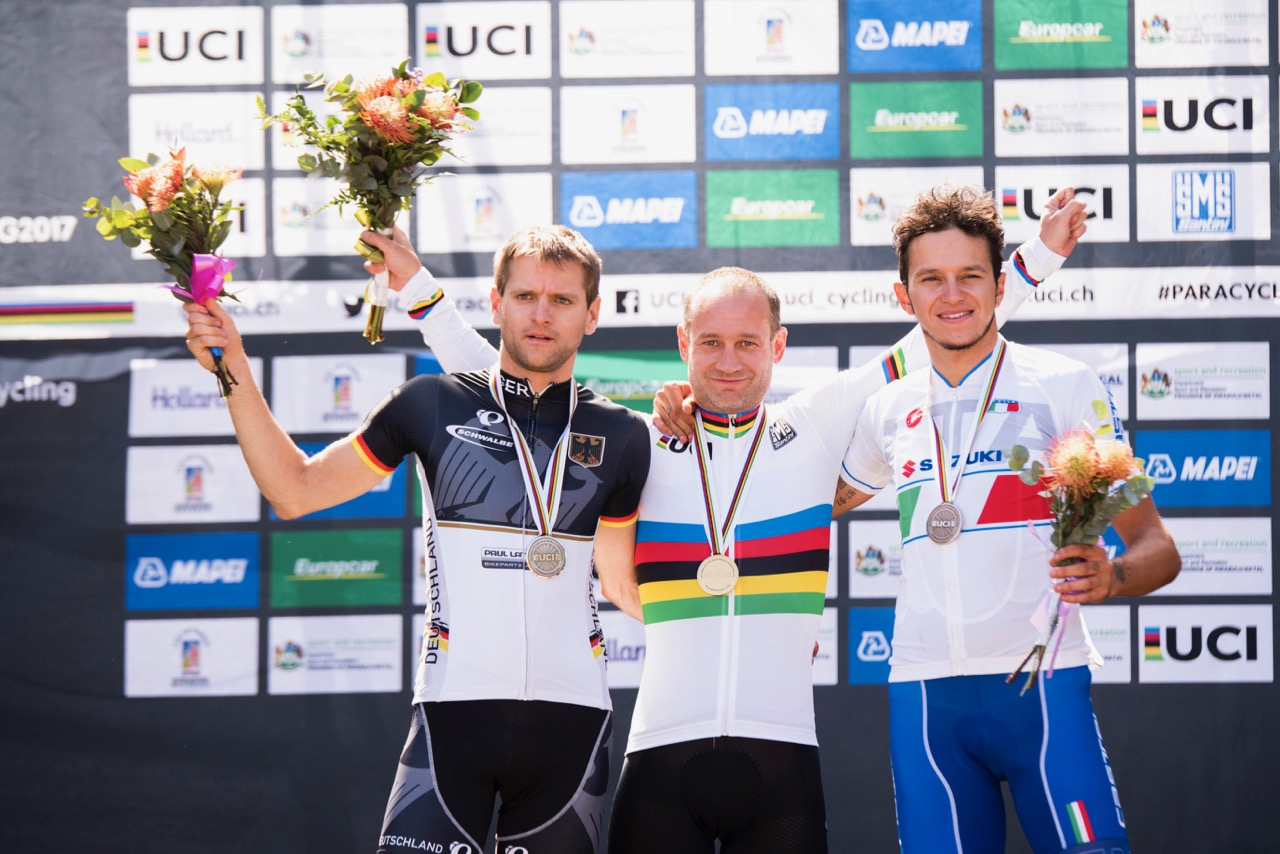 UCI Men C3 World Champion Henrik Marvig (SWE) is flanked by silver medalist Steffen Warias (GER, left) and bronze medalist Fabio Anobile (ITA, right) on Day 4 of the 2017 UCI Para-cycling Road World Championships held at Alexandra Park Pietermaritzburg, South Africa, on Sunday 3 September 2017. Photo credit: Andrew Mc Fadden