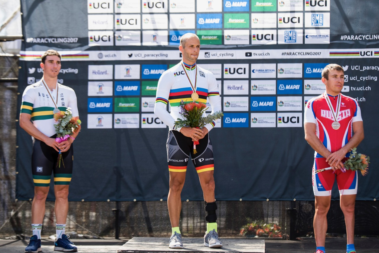 UCI Men C4 World Champion Tobias Vetter (GER) is flanked by silver medalist Kyle Bridgwood (AUS, left) and bronze medalist Sergei Pudov (RUS, right) on Day 4 of the 2017 UCI Para-cycling Road World Championships held at Alexandra Park Pietermaritzburg, South Africa, on Sunday 3 September 2017. Photo credit: Andrew Mc Fadden