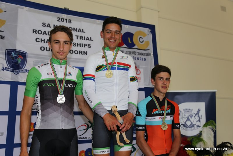 Ricardo Broxham (ProTouch-centre) flanked by teammate Tiano da Silva (left) and Cian Leveridge (Absolute Motion-right) on the Junior Men's podium at the 2018 SA National Road and Para-cycling Championships, which took place in the streets of Oudtshoorn from 6-11 February. 📷 www.cyclenation.co.za