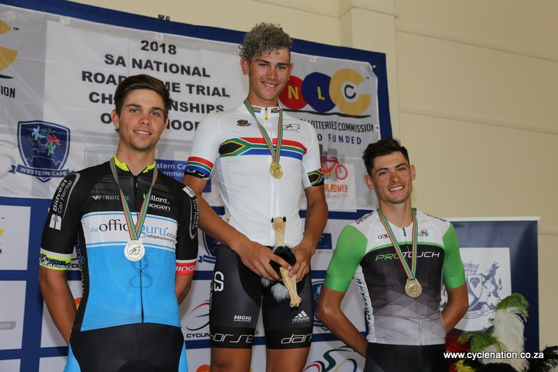 Jason Oosthuizen (Barzani Pro Cycling) proudly wears the National Championships jersey, flanked by Ryan Harris (Office Guru-left) and Gustav Basson (ProTouch-right) on the U23 Men's podium at the 2018 SA National Road and Para-cycling Championships, which took place in the streets of Oudtshoorn from 6-11 February. 📷 www.cyclenation.co.za