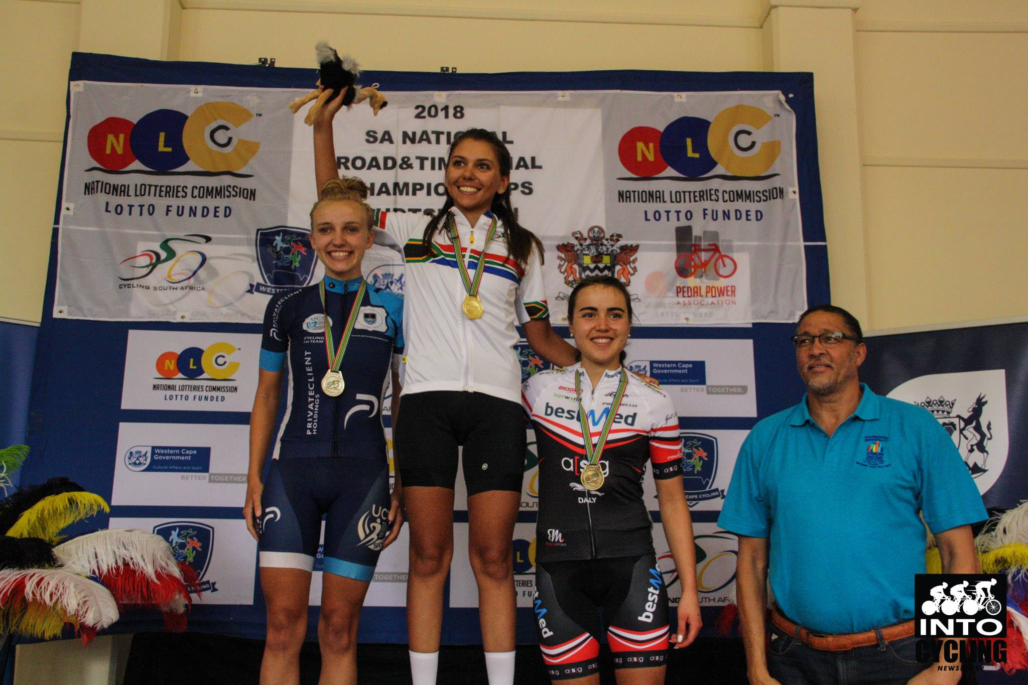 Catherine Colyn   (Maaslandster International Women's Cycling Team) celebrates her victory in the U23 Women's Road Race flanked by Courteney Webb (UCT Cycling Team-left) and Danielle Strydom (Team Bestmed-right) on the U23 Women's podium at the 2018 SA National Road and Para-cycling Championships, which took place in the streets of Oudtshoorn from 6-11 February. 📷 www.intocycling.co.za