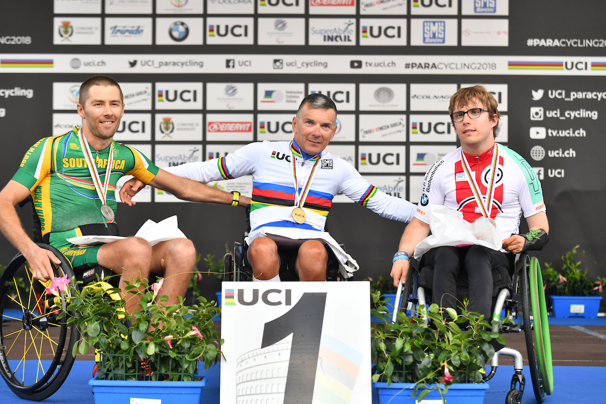 Pieter du Preez won a silver medal in the Time Trial at the 2018 UCI Para-cycling Road World Cup in Maniago, Italy - with him is winner Fabrizio Cornegliani (ITA) and third-placed Benjamin Fruh (SUI). Photo credit: SWpix.com