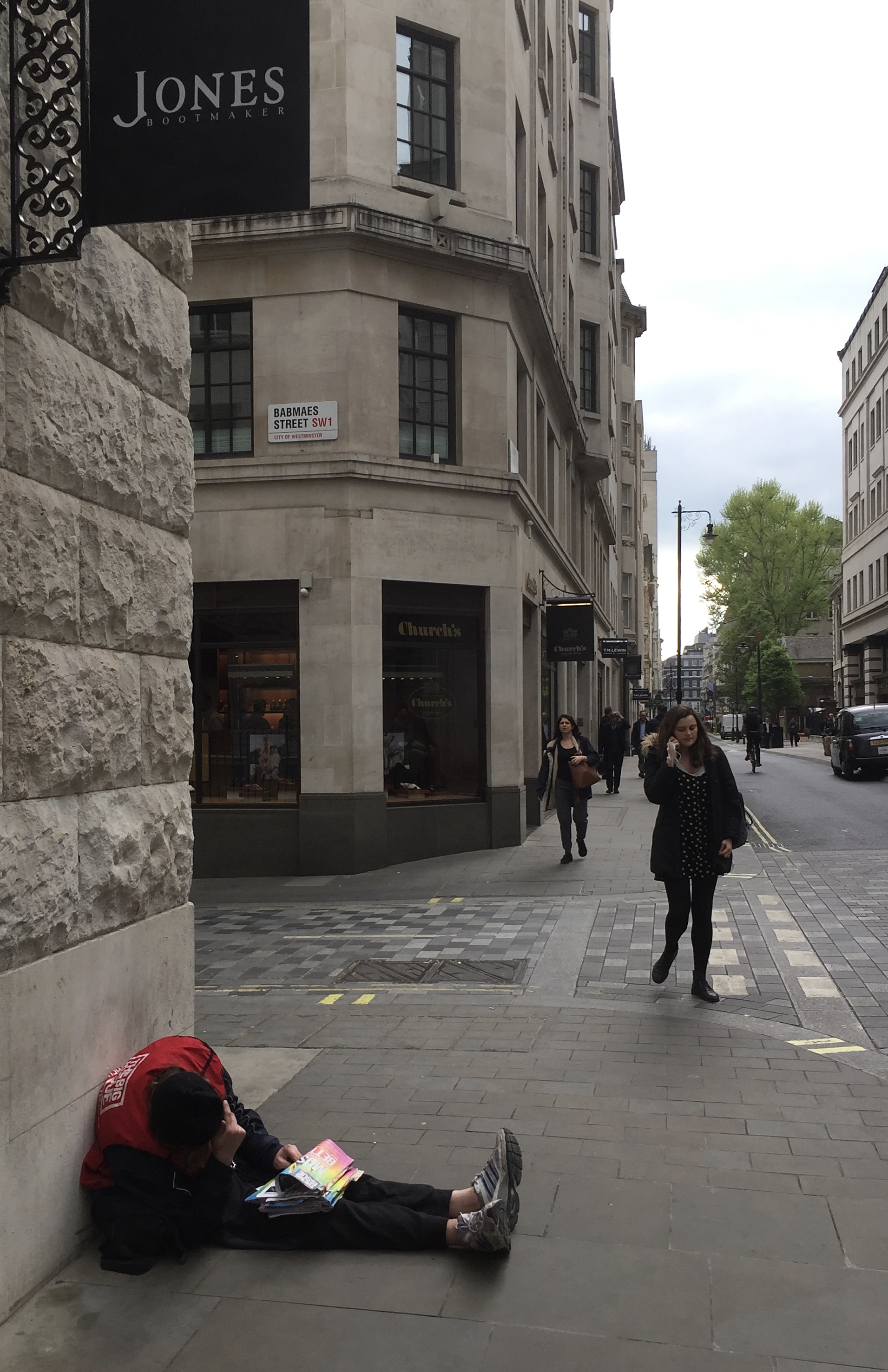 Jermyn Street; a pissed Big Issue seller lies amidst Jones and Church's shoe shops. Maybe he's saving for a new pair?