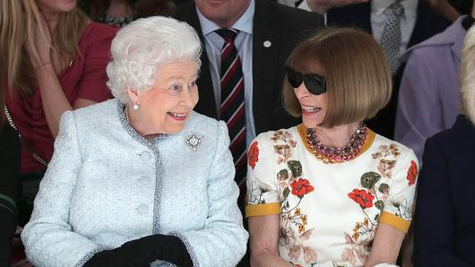 Queen Elizabeth II  sits with  Anna Wintour  at  Richard Quinn's  runway show before presenting him the inaugural  Queen Elizabeth II Award for British Design.  Image: KGC-375/STAR MAX/IPx via CNBC.