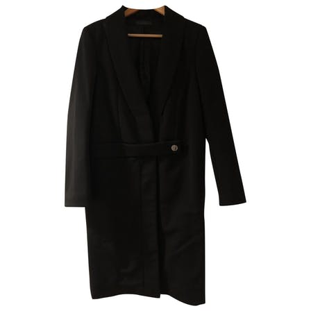 Black wool coat from The Row; image via Vestaire.