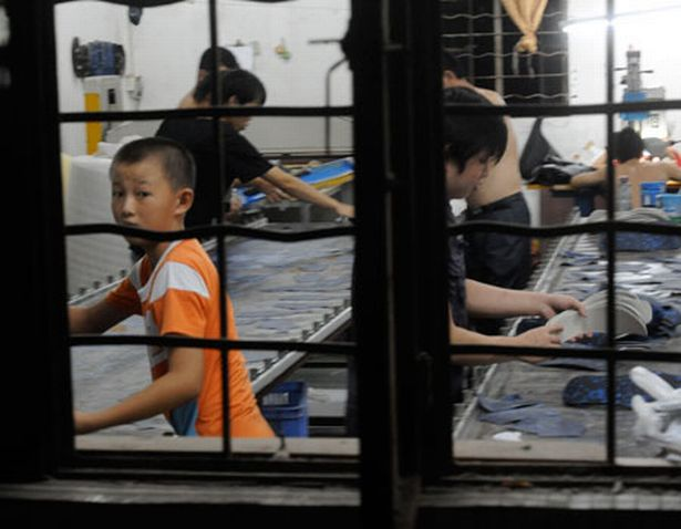 Fake designer boots are made by children in China. Image: The Mirror