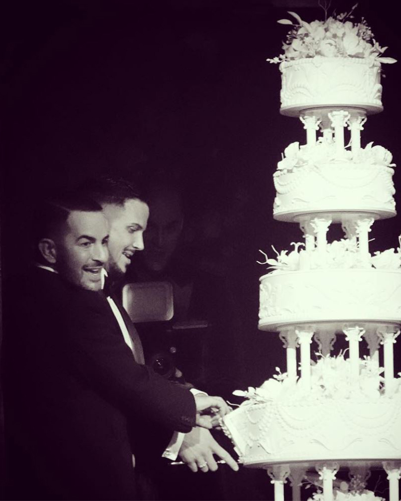 Cutting the cake; image via FQ.