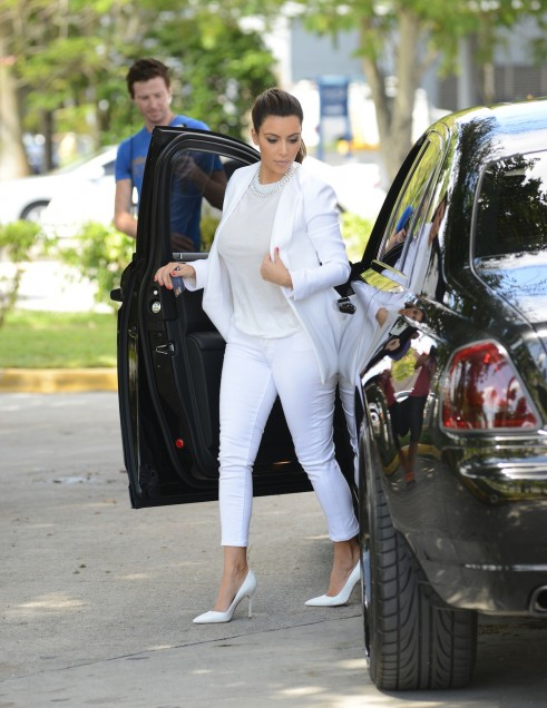 Kim Kardashian in high-rise, ankle-length white denim; image via Pinterest.