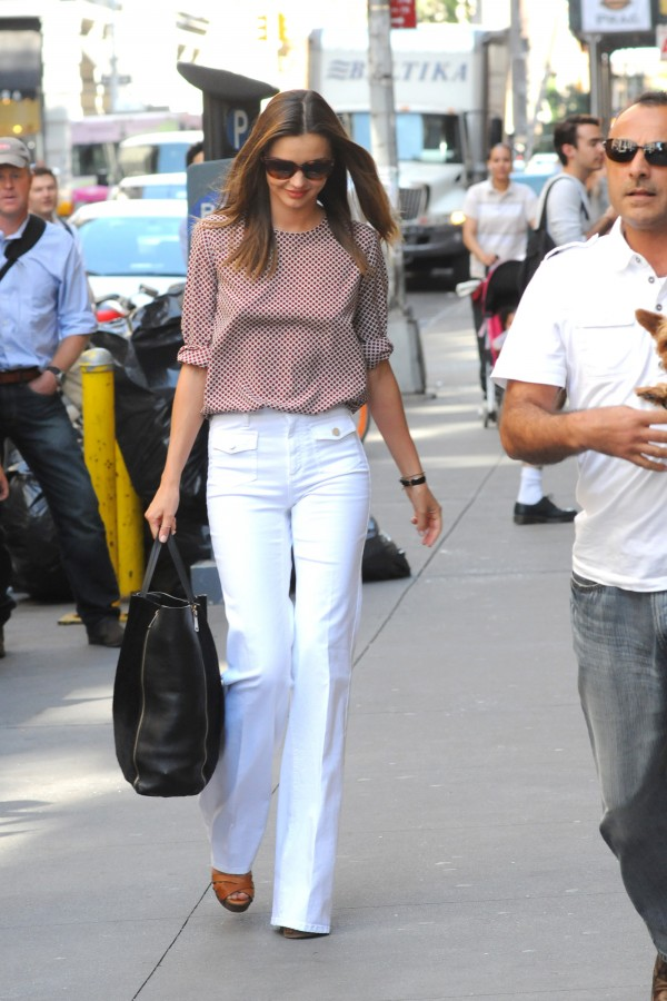 Miranda Kerr in Stella McCartney flares; image via Denim Blog.