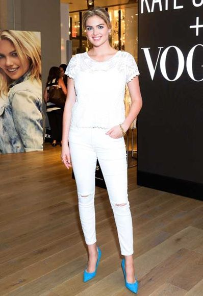 Kate Upton in mid-rise, narrow-leg white jeans; image via Pinterest.