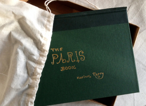 THE PARIS BOOK LIMITED EDITION. The Paris Book by Marian Parry (Un-Gyve Press, Boston) limited edition of 333 signed and numbered by the artist; a hand-bound, cloth-covered book in gold-stamped box and cotton satchel with twenty carefully reproduced watercolours. ( PRNewsFoto/Un-Gyve Press )