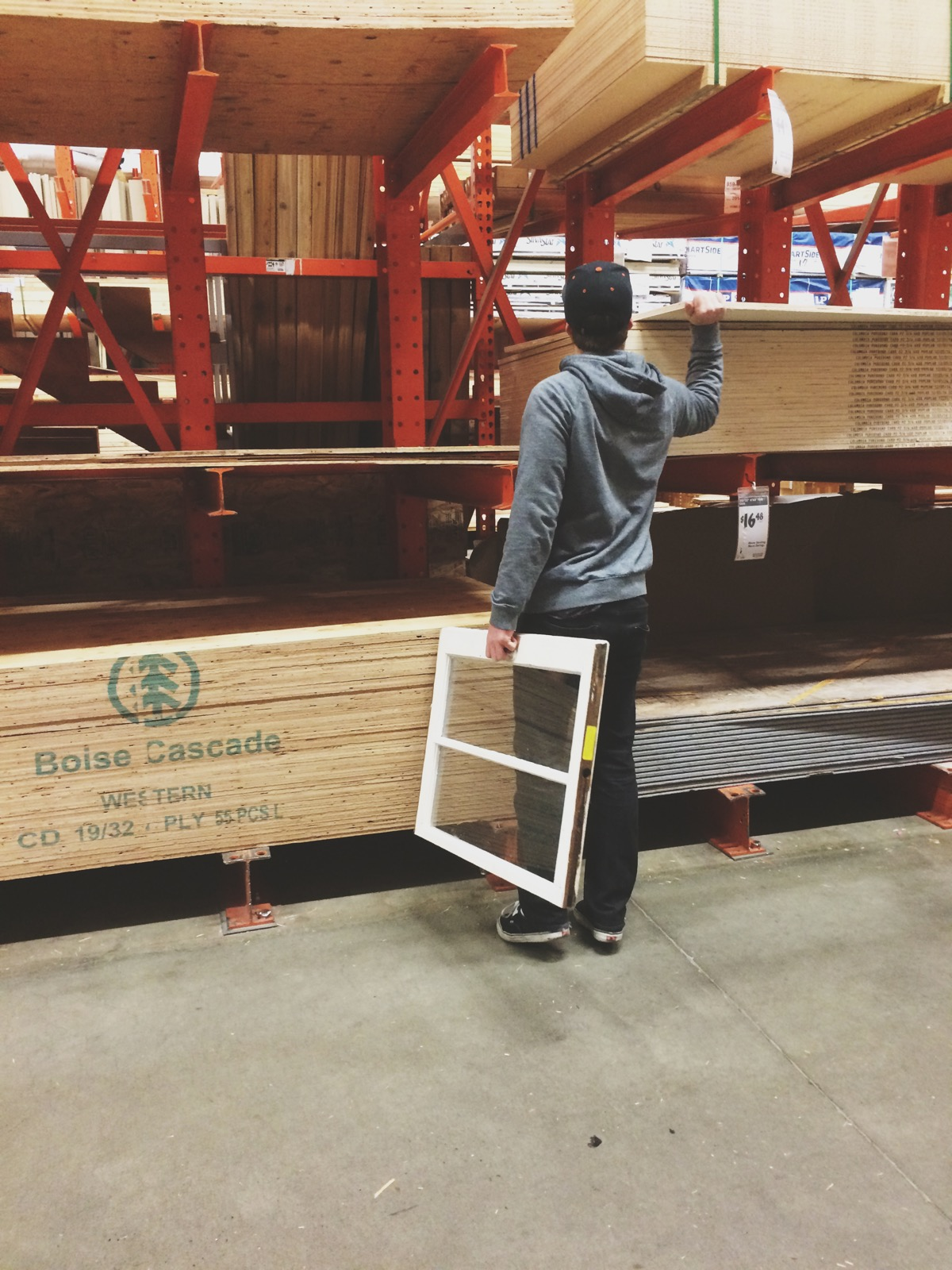 Marshal, best boyfriend ever, at Home Depot in search of the best wood for our DIY projects