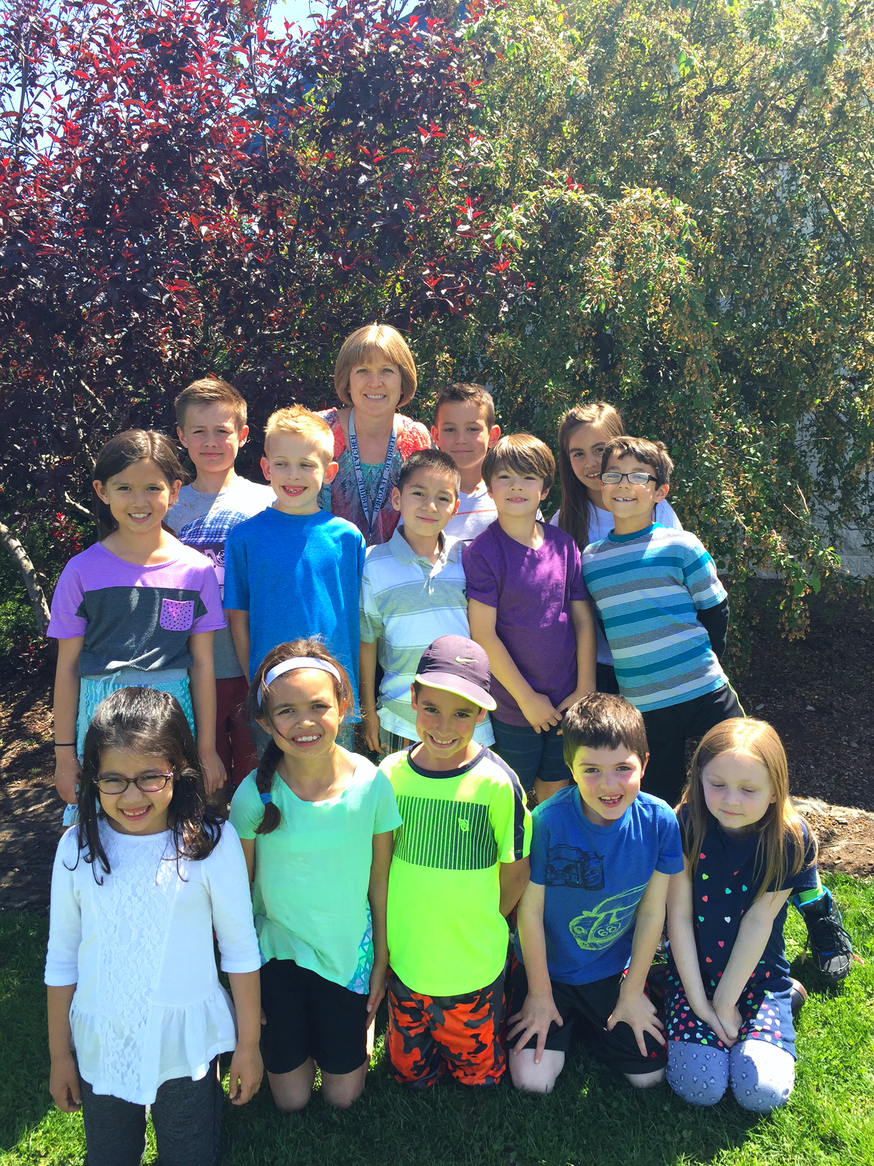 Tonya Wessman (back, center) with her first and second grade class from Rogers Adventist School