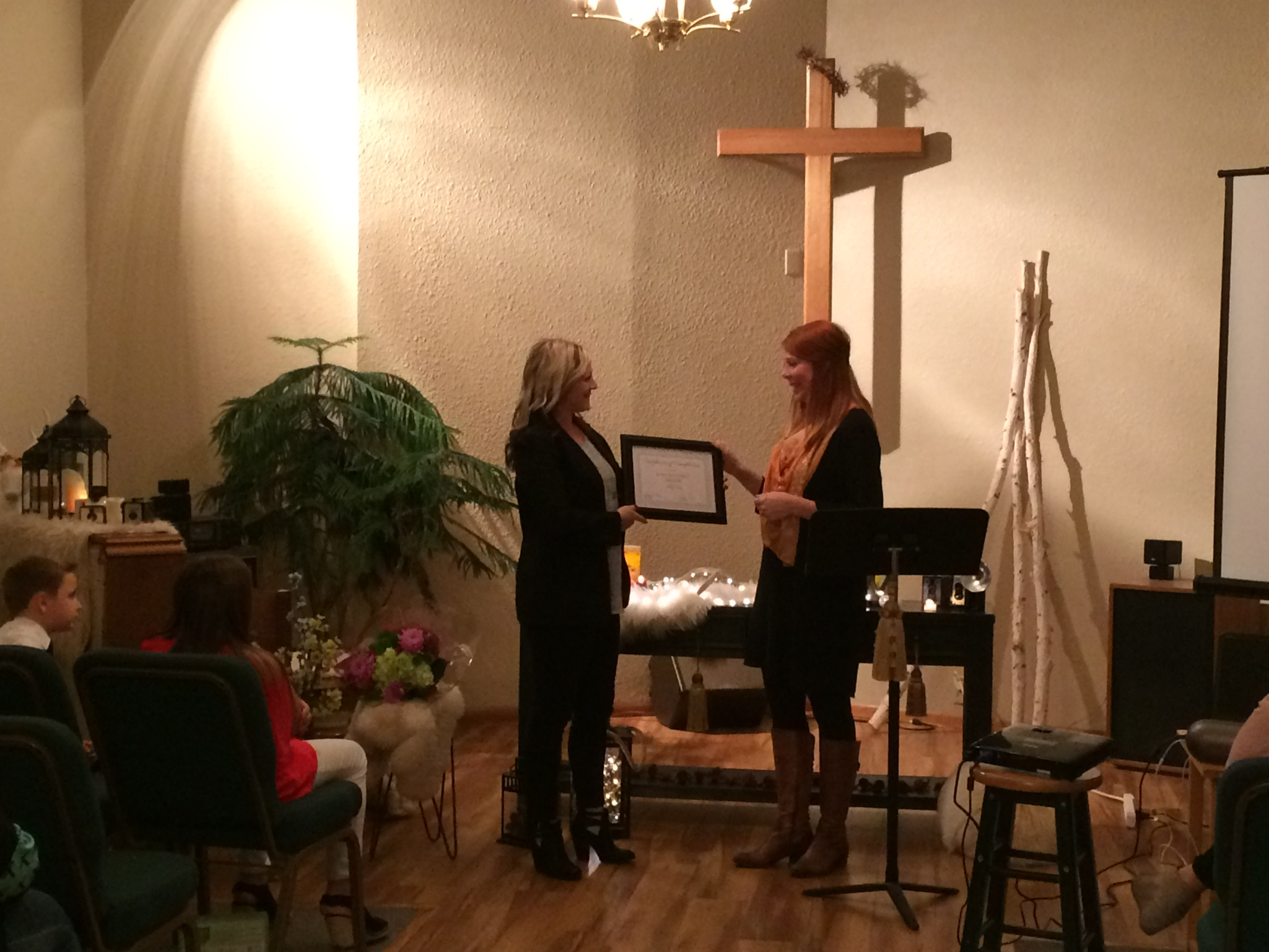 The CAC's most recent graduate of the Healing Home Program receiving her diploma on October 3.