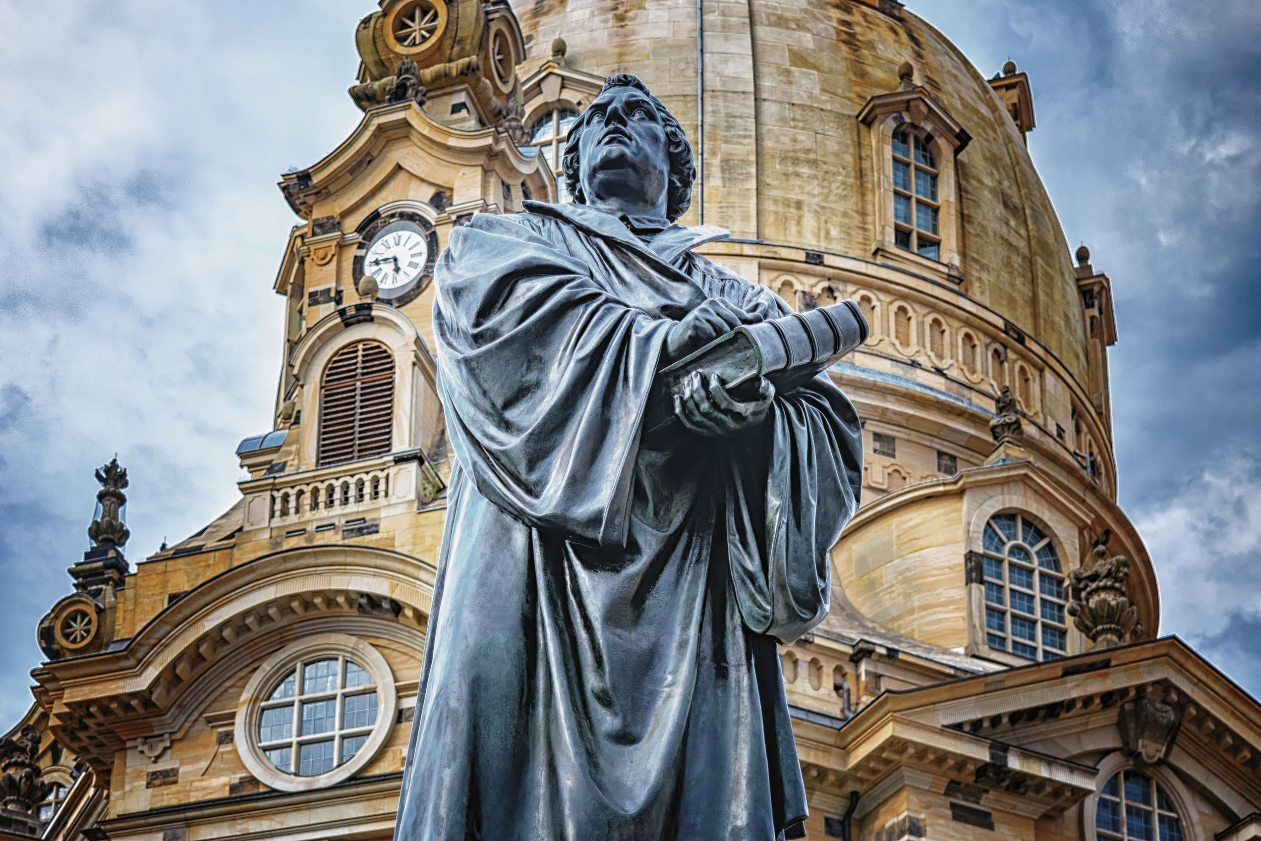 Statue of martin luther in front of the frouenkirche, dresden,germany photo courtesy of pixabay.com