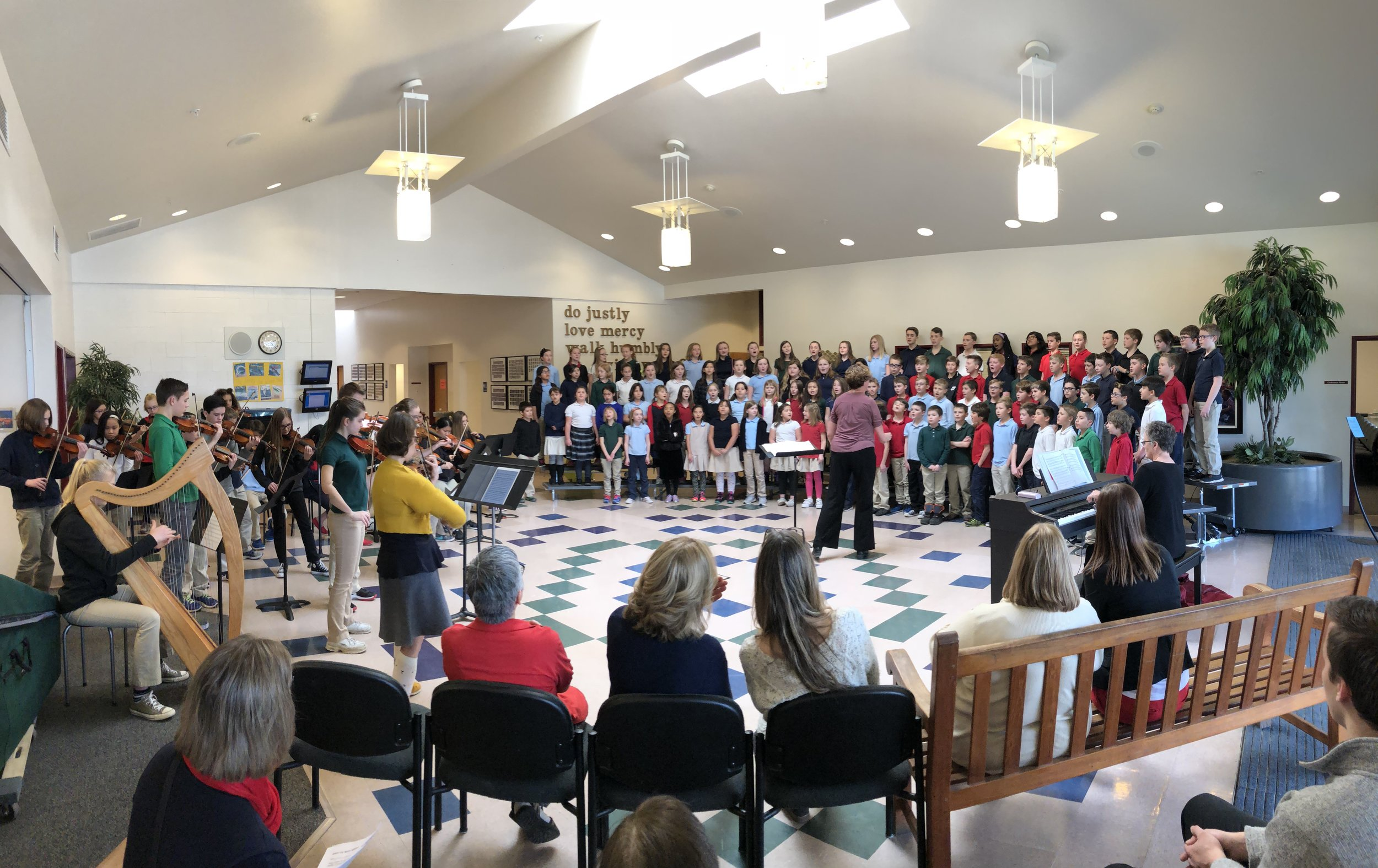 patti short directing rogers adventist school treble choir and con brio in rogers' lobby this week.