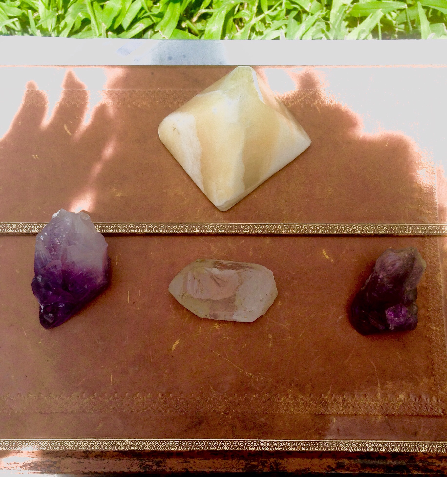Amethyst Points Amped by Clear Quartz and a Sandstone Pyramid. Charged by the sun and observed by the shadow.
