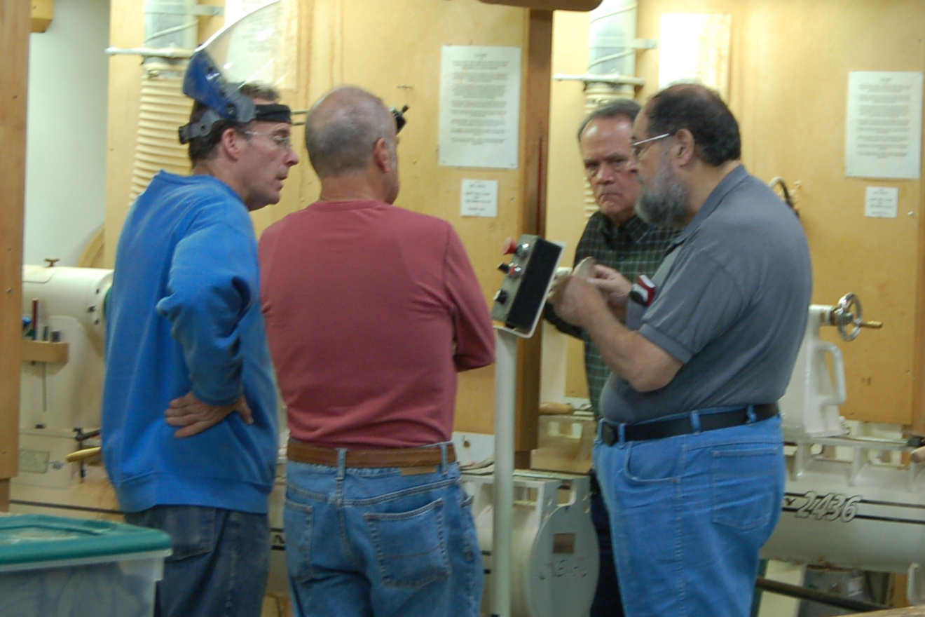 Bryan, Phil Hauser, Linford Sine and Joe Seltzer discuss the finer points of coring.