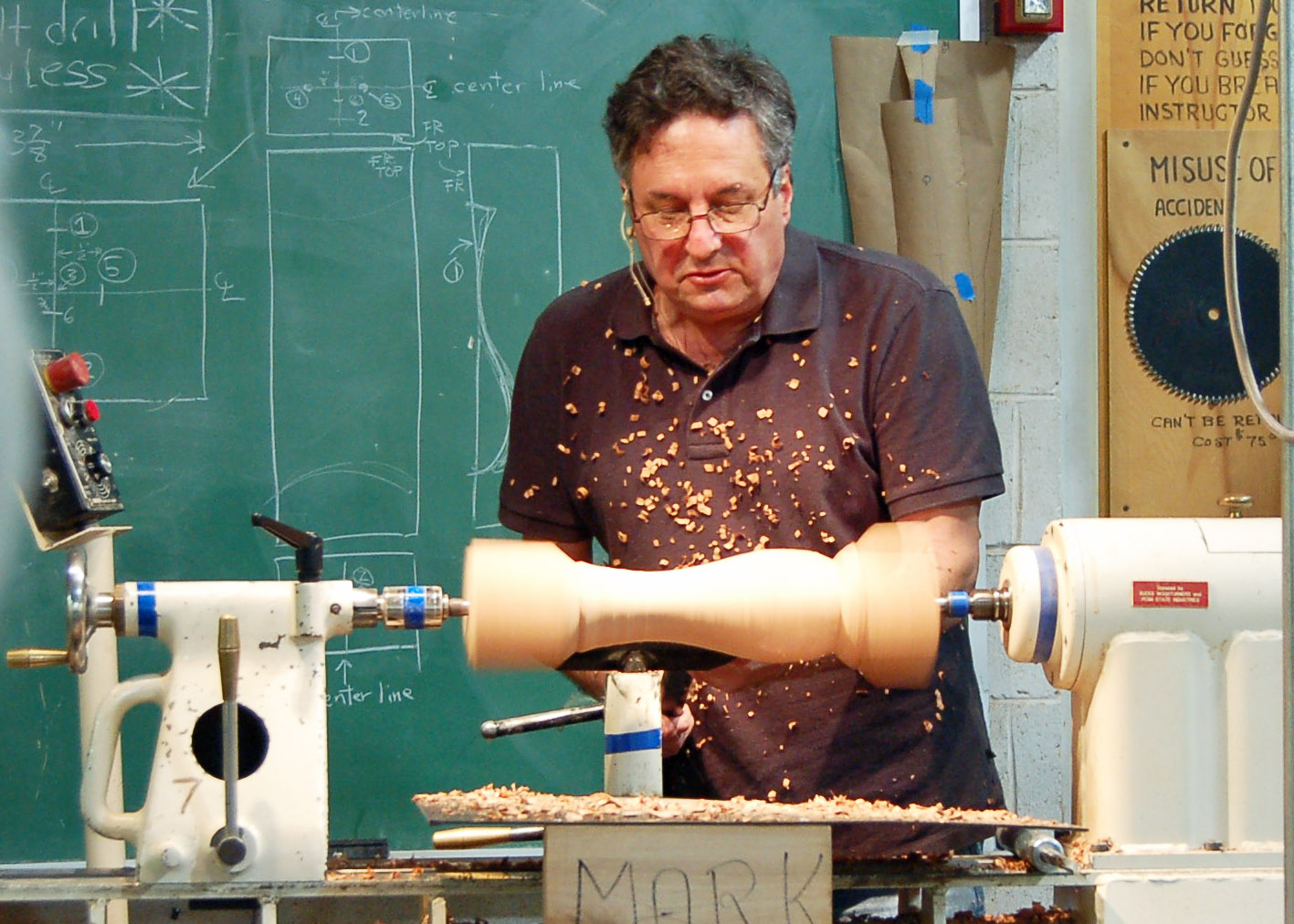 After having made the arch cut, Mark uses the roughing gouge to remove wood fast.