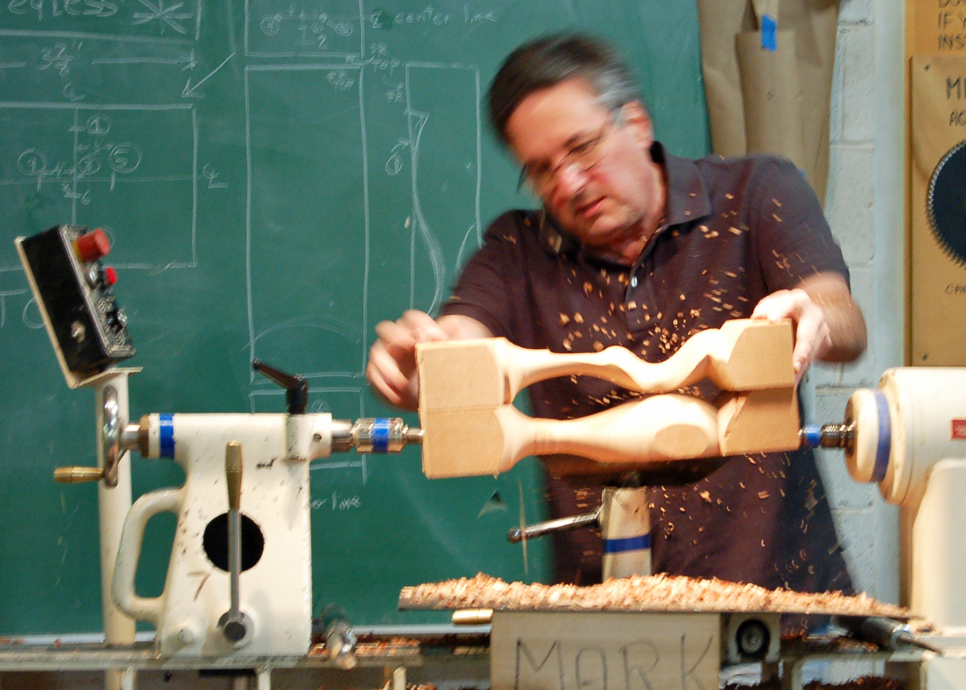 Mark checks the depth of cut along the figure using his model.