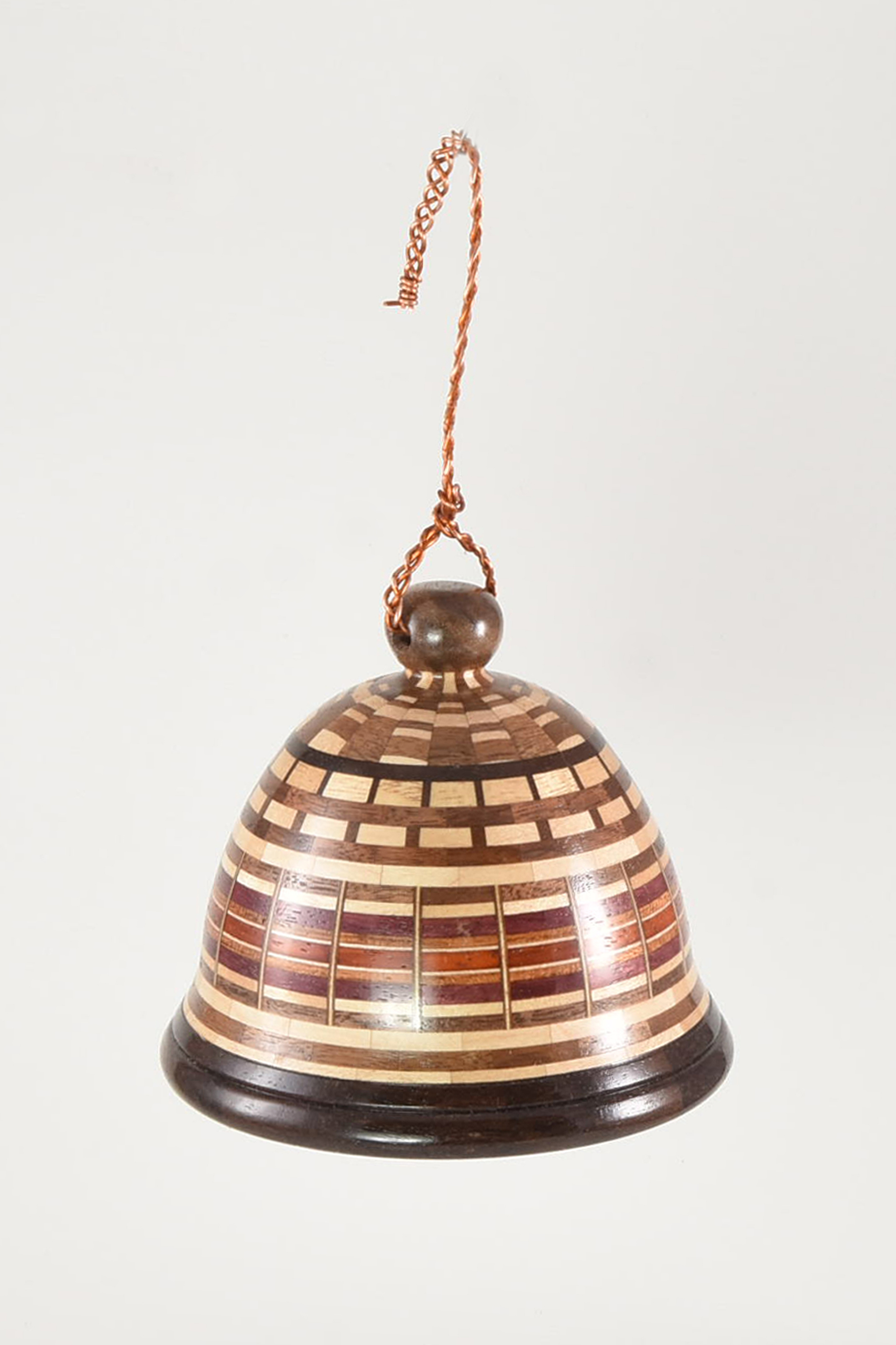 """The 4.0"""" diameter segmented wood bell is made from walnut, maple, padauk and katalox woods. There are 18 segments per layer and the bell consists of a total of 540 wood segments. -John Manura"""