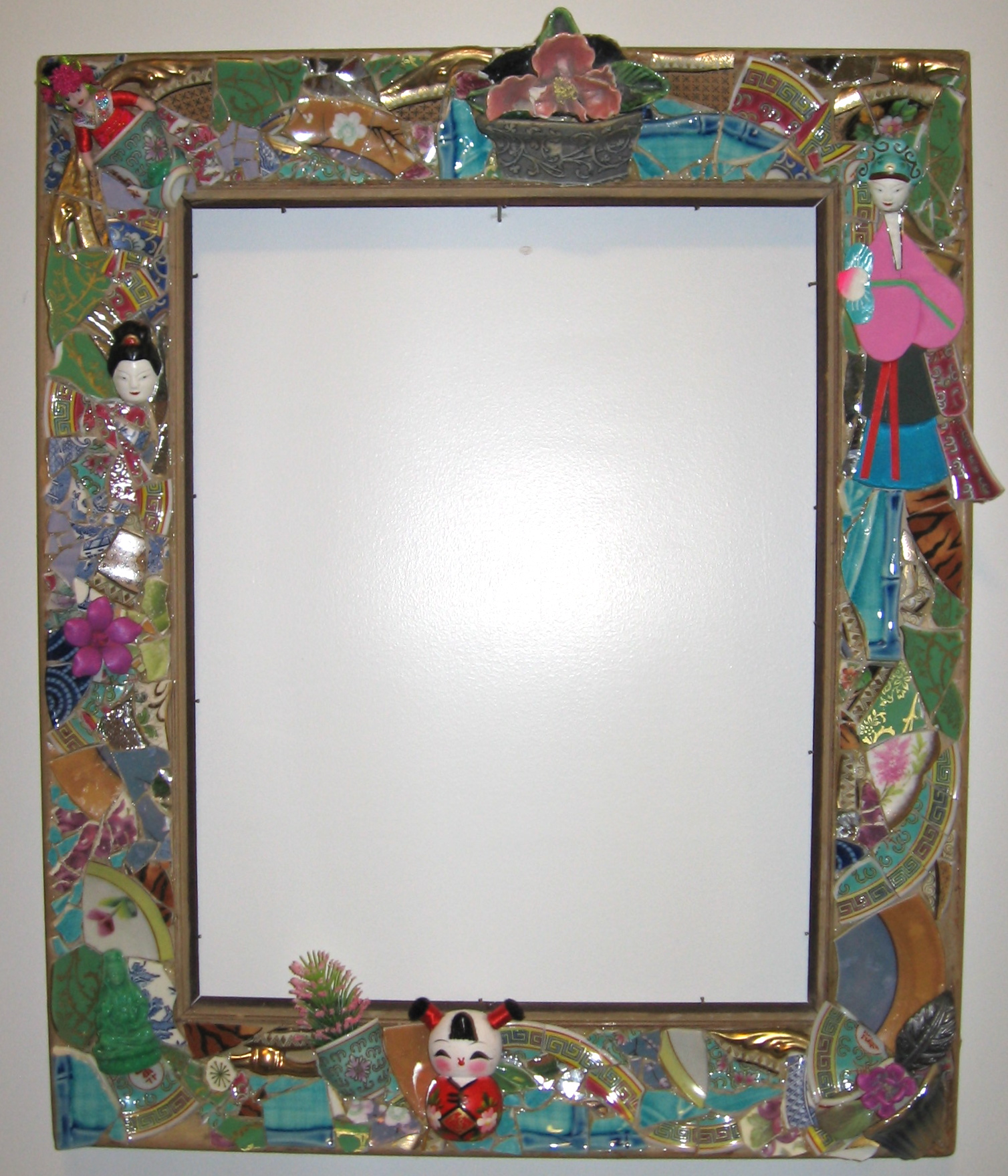 Asian Assemblage Mirror. 22x18 $750