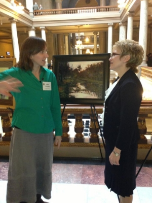 """Hirschten speaking with Lt. Governor Sue Ellsperman upon being honored for her painting """"6pm on the Canal"""" at the Indiana State Capitol in 2013."""