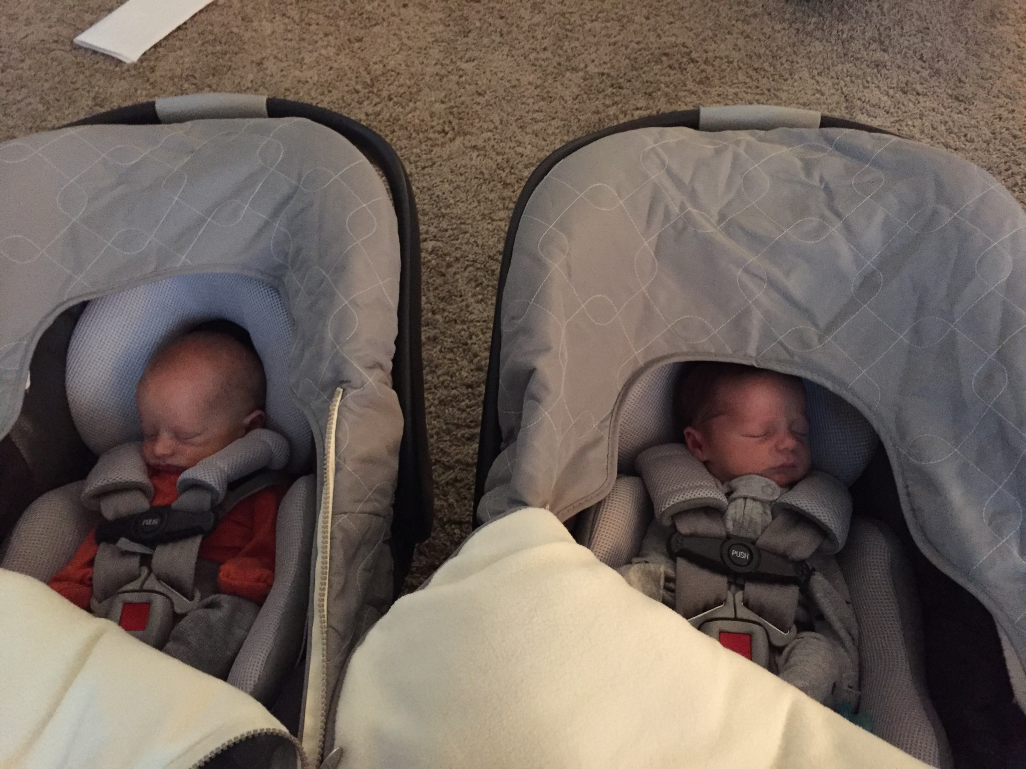 After the pediatrician, napping in their carseats - 1 week old