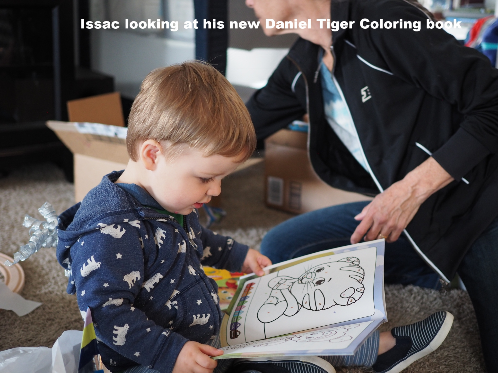 Isaac enjoying his new Daniel Tiger coloring book