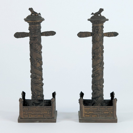 PAIR-OF-QING-DYNASTY-BRONZE-CANDLE-STANDS-.png