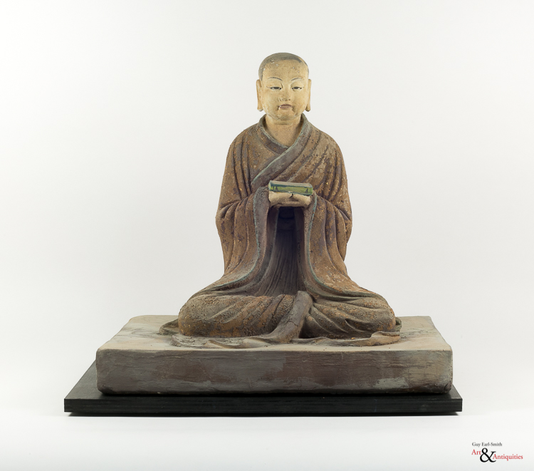 A Painted Clay Ming Dynasty Sculpture of a Luohan,c. 1368-1644