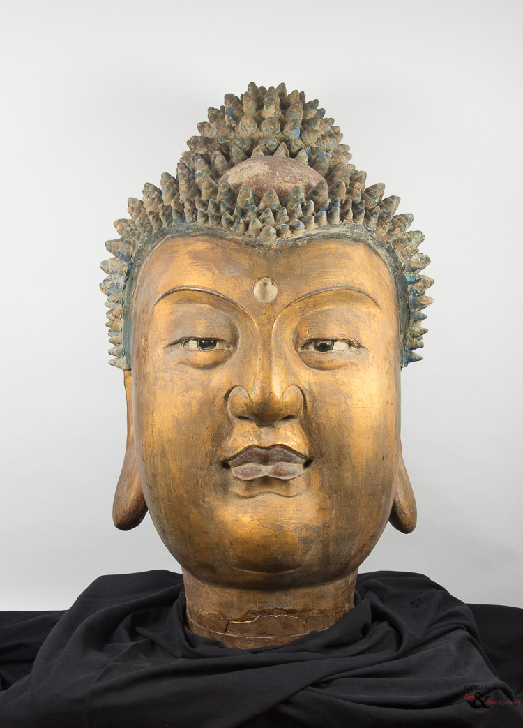 A Gilded and Painted Clay Ming Dynasty Head of Buddha, c. 1368-1645