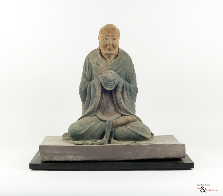 A Painted Clay Ming Dynasty Sculpture Of A Luohan, c. 1368-1645