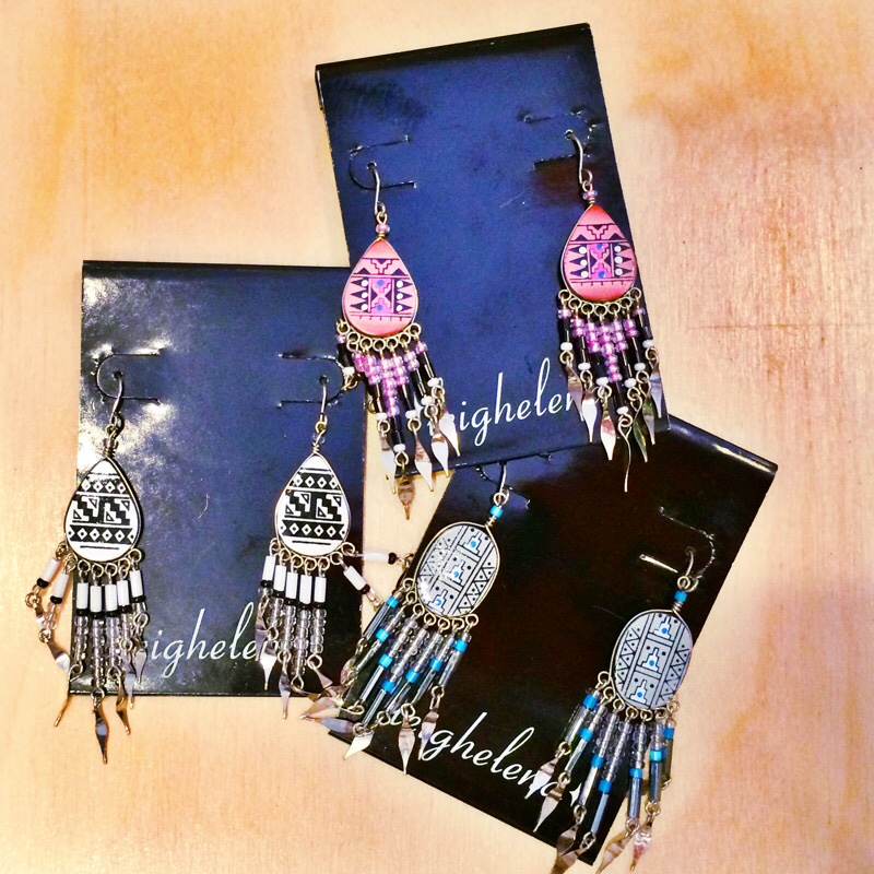 Raquel Greer Gordian displays a selection of statement earrings from the Austin boutique Leighelena.