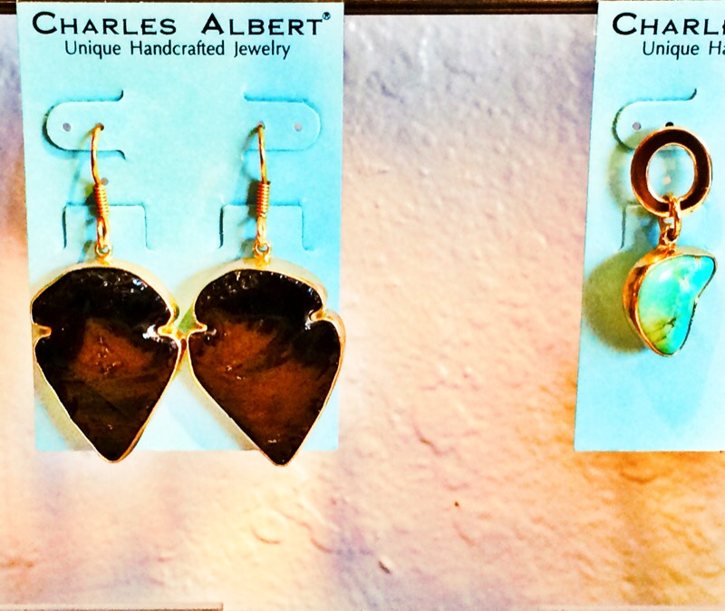 Raquel Greer Gordian exhibits a pair of handcrafted earrings from Leighelena.