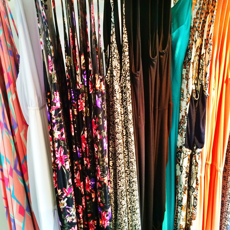 Raquel Greer Gordian displays an array of colorful and printed maxi dresses from Southern Hippie.